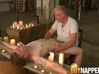 Sebastian Kane caresses sub youngster with candle wax